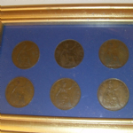 1919-1922 United Kingdom One Penny pieces mounted in frame